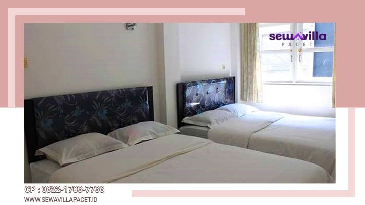 kamar tidur di villa lahor dengan bed king size