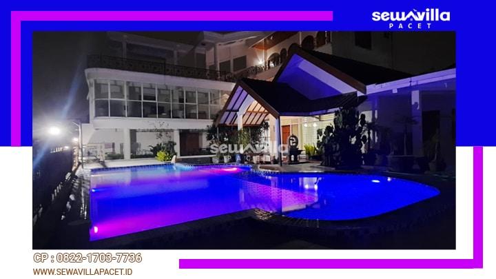 villa tiyasa batu kolam renang dengan lampu yang indah di malam hari